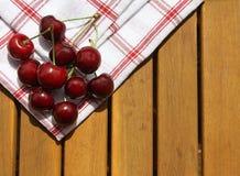 Cereja na madeira Imagens de Stock Royalty Free