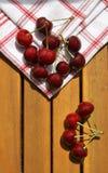 Cereja na madeira Fotos de Stock Royalty Free