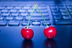 A cereja no teclado foto de stock royalty free