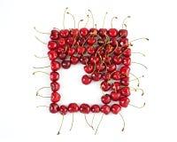 Cerejas maduras colocadas no quadrado Imagens de Stock Royalty Free