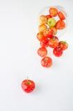 Cerejas no copo no branco Fotografia de Stock