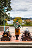 Ceremonial Bagpipe Performance at Nanaimo, BC. A Scottish bagpipe player performs prior to the daily cannon firing ceremony at the historic Bastion. The daily royalty free stock photo