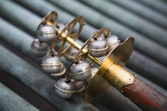 Ceremonial bells in Japan. Ceremonial balls adorn the end of a pole in Japan Royalty Free Stock Photos