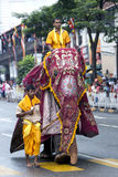 A ceremonial elephant heads down a street in Kandy towards the marshalling area for the Day Perahera in Sri Lanka. Stock Images