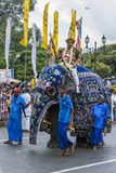 A ceremonial elephant parades along a Kandy street during the Day Perahera in Sri Lanka. Royalty Free Stock Photography