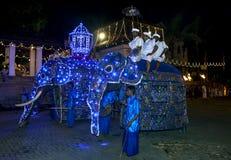 Ceremonial elephants prepare to parade through the streets of Kandy during the Esala Perahera in Kandy, Sri Lanka. Stock Photo