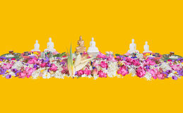 Ceremonial flowers and buddha figurines Royalty Free Stock Images