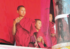 Ceremonial Lamas in the Buddhist rituals. At Riku temple. Kangding county., sichuan royalty free stock photos