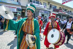 A ceremonial parade takes place down the main street of Elmail prior to the commencement of the Elmali Turkish Oil Wrestling Festi Royalty Free Stock Photography