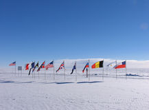 Ceremonial South Pole. The Ceremonial South Pole is located near the Geographic South Pole. The flags of the original signatory nations to the Antarctic Treaty stock image