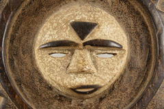 Ceremonial Sun Mask, horizontal detail. Carved wood and painted Ceremonial Sun Mask used in traditional ceremonies in Cameroon, West Africa Royalty Free Stock Photo