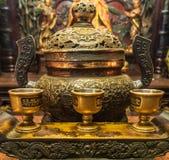 Ceremonial tea cups at Man Mo Yi Tai Temple in Fu Shin Street, Hong Kong China. Hong Kong, China - March 8, 2019: Man Mo Yi Tai Taoist Temple in Fu Shin Street stock photo