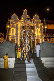 The Ceremonial Tusker exits the Temple pof the Sacred Tooth Relic in Kandy in Sri Lanka during the Esala Perahera. The Mangala Hasthirajaya (Ceremonial Tusker) stock photography