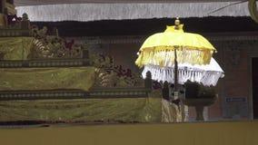 Ceremonial umbrellas in the temple, Bali, Indonesia. Ceremonial umbrellas in the temple, Bali Indonesia stock footage
