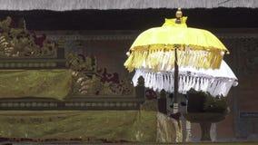 Ceremonial umbrellas in the temple, Bali, Indonesia. Ceremonial umbrellas in the temple, Bali Indonesia stock video footage