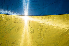 Ceremonies dedicated to the Day of State Flag of Ukraine. KIEV, UKRAINE - Aug 23, 2015: Ukrainian flag presented by brigade 81 with the signature of President of stock photos