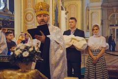 Ceremony of christening. LUTSK, UKRAINE - 26 March 2017: The ceremony of christening the little girl at church Royalty Free Stock Photos