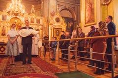 Ceremony of christening. LUTSK, UKRAINE - 26 March 2017: The ceremony of christening the little girl at church Royalty Free Stock Image