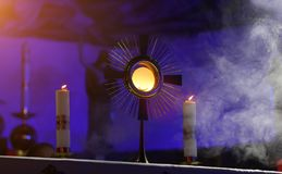 A ceremony in the church to issue the Monstrance. A ceremony in the church to display the Monstrance by candlelight royalty free stock photography