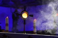 A ceremony in the church to issue the Monstrance. A ceremony in the church to display the Monstrance by candlelight stock photography