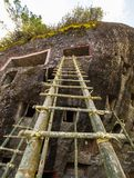 The Ceremony of Cleaning Corpses. Open graves in a cliff with bamboo stairs for access during the ceremony of cleaning corpses (Manene in local language), held Stock Images