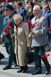 Ceremony of laying flowers to the Tomb of the Unknown Soldier. MOSCOW, RUSSIA - MAY 8, 2014: Military servicemen, officials and war veterans at the ceremony of Royalty Free Stock Image
