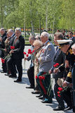 Ceremony of laying flowers to the Tomb of the Unknown Soldier. MOSCOW, RUSSIA - MAY 8, 2014: Military servicemen, officials and war veterans at the ceremony of Royalty Free Stock Photos