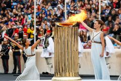 Ceremony of the Olympic Flame for Winter Olympics. Athens, Greece - Oct 31,2017: The Olympic flame was handed to organizers of the Pyeongchang South Korean Stock Photos