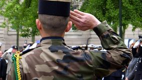 Ceremony to mark Western allies World War Two victory Armistice. Rear view of solider saluting at Ceremony to mark Western allies World War Two victory Armistice royalty free stock photography