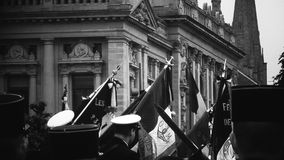 Ceremony to mark Western allies World War Two victory Armistice. Unrecognizable men holding French flags ceremony to mark Western allies World War Two victory royalty free stock image