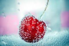 Cereza grande en burbujas Imagen de archivo