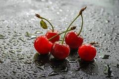 Cerezas en la lluvia Foto de archivo
