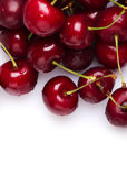 Cerezas frescas rojas Foto de archivo