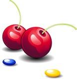 Cerezas y caramelo Imagen de archivo libre de regalías