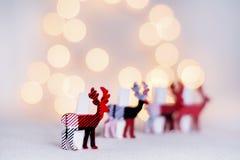 Cerfs communs de Noël sur un fond blanc de bokeh Photographie stock libre de droits