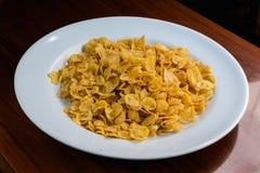 Cerial on white dish. Corn Flakes on white dish Stock Photo