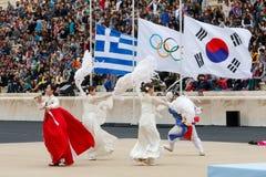 Cerimônia da chama olímpica para Olympics de inverno imagem de stock