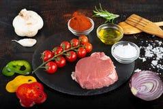 Cerise et huile de tomate d'ail Photos stock