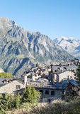 Cerler village. Where you see some stone houses surrounded by hight mountains on a clear day. It is located in the Spanish Pyrenees in Huesca.It´s a vertical royalty free stock photos