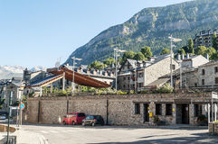 Cerler village. Where you see some stone houses surrounded by hight mountains on a clear day. It is located in the Spanish Pyrenees in Huesca royalty free stock image