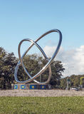 Cern symbol. In an iron sculpture in Switzerland, is a vertical image on a sunny day Royalty Free Stock Photography