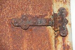 Cerniera di porta arrugginita Fotografia Stock