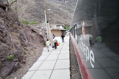 Copper canyon train, in Mexico. CEROCAHUI, MEXICO - CIRCA MAY 2012 - Tourists taking pictures along from the train in the Copper canyon in Mexico, while others Royalty Free Stock Images