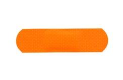 Cerotti adesivi arancio isolati su fondo bianco Fotografia Stock Libera da Diritti