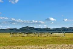 cerque en WulanBu todo el campo de batalla antiguo del prado Fotografía de archivo