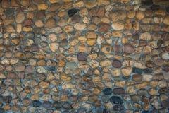 Cerrado encima de fondo de la pared de piedras de la roca Imagenes de archivo