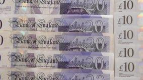 Cerrado para arriba de billetes de banco de la libra esterlina metrajes