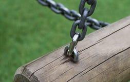 Cerradura de las cadenas en el registro Imagen de archivo libre de regalías