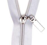 Cerradura gris en la ropa en el fondo blanco Foto de archivo libre de regalías