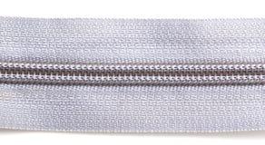 Cerradura gris en la ropa en el fondo blanco Foto de archivo